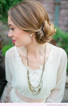 Low side bun for the bride, love her make-up too