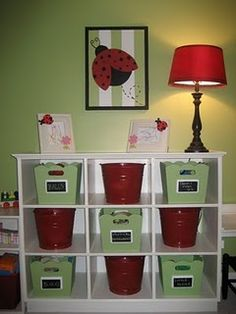 red buckets used along with some black or tan square baskets for Cayson's firetruck themed bedroom.... he really needs this in his closet!