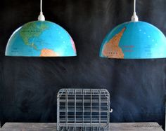 Pendant lamps made from a globe. GENIUS! I wonder if it's easy to take apart.