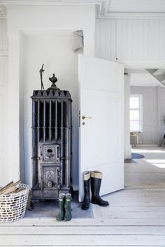 Wood burning stove in a dreamy, rural Swedish summer cottage / Erica Franzén