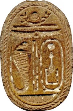 Scarab with a Ram's Head- Back--The amulet should secure the royal authority (cartouche) of this king, as well as the divine support (ram head, solar barque) and protection (winged sun-disk, cobra) for the king; it also could provide an elite owner with royal patronage and divine protection.