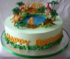 #dinosaur #birthday #cake featuring dinosaurs gathered around a watering hole. Plastic dinosaur toys and trees.