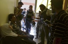 U.N. chemical weapons experts visit site of an alleged chemical weapons attack in Damascus suburb