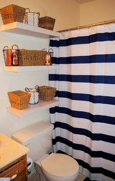 College apartment bathroom I like the idea of different items in different baskets