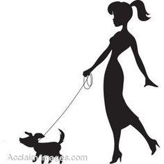 Silhouette of a Young Woman Walking a Dog