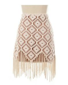 "Fancy, Free Fringe-Ohhh lala! ""Fancy, Free Fringe"" is a fun and funky skirt! The diamond crochet patterned skirt has a tan colored lining and hanging fringe at the hem. It zips on the side. Try this skirt with an oversized sweater and bootie!"