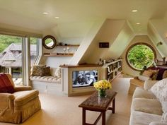 I love the structure of the diagonal walls and how cozy they make the room feel...