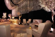 Designer 8 supplied furnishings, First Circle Design provided lighting design with equipment from ShowPro, and Goodman handled the sound. Dazian installed sparkle drape in the party space and created a perimeter of silver beaded curtains.  Photo: Nadine Froger Photography