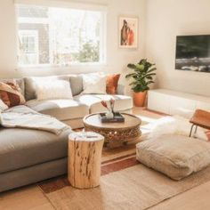 A living room in Boulder Colorado featuring West Elm s Haven Sectional Carved Wood Coffee Table and Natural Tree-Stump Side Table drsashafluss itskennywithrow Boho Living Room, Home And Living, Living Room Decor, Modern Living, Living Rooms, Small Living Room Sectional, Bohemian Living, Minimalist Living, Living Room Natural Decor