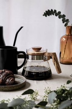 Freshly brewed pour-over coffee in a Hario glass and olive wood server. Ways To Make Coffee, Coffee Games, Coffee Guide, Glass Measuring Cup, Coffee Business, Digital Kitchen Scales, Caffeine Addiction, Brewing Equipment, Black Liquid