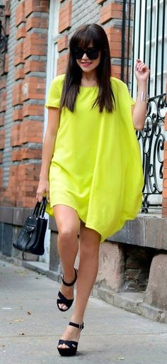 Gorgeous short sleeves lemon summer dress with black leather hand bag and black leather sandals and black goggles the best street fashion inspiration and cute looks: