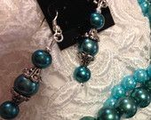 TEALS GLAMOUR: What makes these earrings unique? Its color. Teal is a combination of blue mixed with green hues. This color is worthy of being noticed because of its elegant shade. The design is approximately 1.5 inches in length or 2.5 inches long with the attached hooks. The earring hooks are unlikely to cause an allergic reaction since they are Hypo-Allergenic. These earring come with a pair of rubber safety backs.