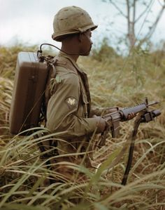 "An American soldier demonstrating the XM-2 Personnel Detector, a ""people sniffer"" used to find enemy soldiers in hidden positions by detecting the chemical traces of urine and sweat during the Vietnam War, 1967."