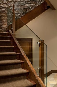 Glass and wood railing design by manchester architects inc indoor stair railing, staircase railings, Wooden Staircase Railing, Indoor Stair Railing, Stair Railing Design, Railing Ideas, Balustrade Design, Glass Balustrade, Deck Railings, Stairs With Glass Panels, Glass Stairs