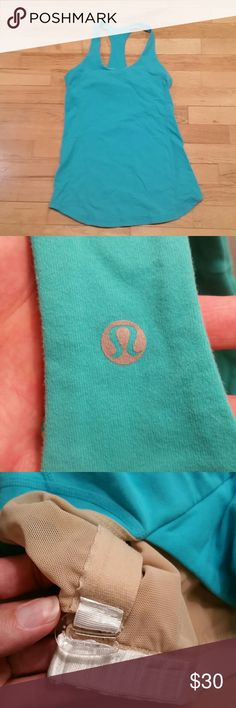 Lululemon Scoop Tank Top Size 6 Green (see phoylto with emblem) scoop tank top, built in, adjustable bra.  NO PADS Worn only a handful of times. Great condition. No stains or signs of wear. lululemon athletica Tops Tank Tops
