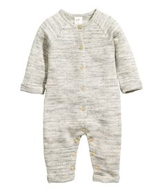 Light gray melange. BABY EXCLUSIVE/CONSCIOUS. Jumpsuit in soft, melange sweatshirt fabric made from organic cotton. Buttons at front and at gusset that