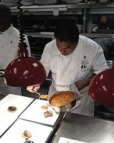 Four Seasons Resort Lanai, The Lodge at Koele Introduces Sustainable Menu at the Dining Room - Chef Junior Ulep adds the finishing touches to his dish.