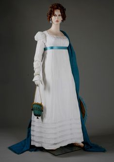 Walking Dress; made to be seen...It would be made in the most fashionable style, with beautiful trimmings, and worn while shopping or walking through the park. A walking dress could also be worn to pay calls on other families. Dresses with low scoop necklines were filled in with a chemisette or dickey of thin material or fichu, a thin scarf tucked into the neckline.