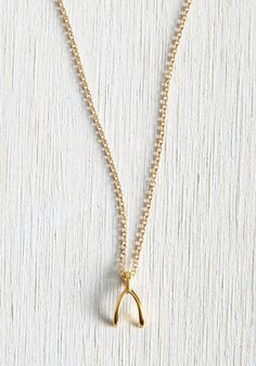Are you a daring dreamer? Full of grand ideas? This pendant necklace reminds you to dream without limits. With a dainty chain and winsome wishbone charm - gold dipped for an extra touch of luxe - this made-in-America accessory aims to be your lucky 'charmer'.