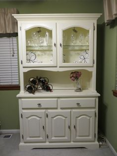 "This newly refinished vintage china hutch will transform any room in your home. The hutch has been transformed from an antique drab looking hutch to a modern and sophisticated eye catcher with a vanilla cream finish, brushed nickle hardware, intricate distressing, and track lighting with a dimmer switch.  Comes in two pieces. The size of the top piece is 46""Wx12.25""Dx45.25""H and the bottom piece measures 48""Wx17.5""Dx33.5""H. Also has beautiful crown molding and magnetic closures. $900"