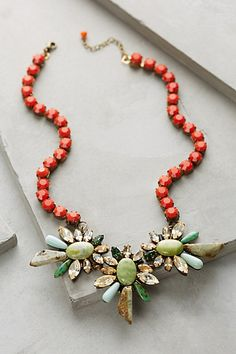 This is an example of emphasis because it puts a focus on the jewels in the center of the necklace