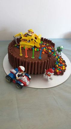 Paw Patrol cake, Birthday party. I made this cake for my boys 4th Birthday. Chocolate cake, chocolate fingers, butter cream icing, m&ms, Rubble on the double, Carmel inside.