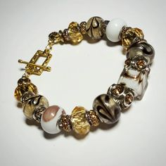 Gold Shimmering Pandora Bracelet Only $21.99 - SALE Gold Pandora Bracelet w/Bejeweled Gems/Shimmering Swirl Blown Glass/Square Lampwork/Iridescent Glitter Disks & Mini Charm FREE SHIPPING https://www.etsy.com/listing/260628031/sale-gold-pandora-bracelet-wbejeweled