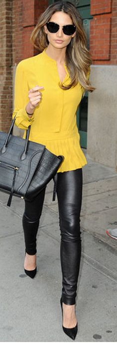 Who made Lily Aldridge's yellow pleated top and black leather handbag that she wore in New York?