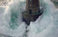 "This photo is part of a series of 7 titled La Jument. The photos were taken in 1989 by photographer Jean Guichard, and depict the French lighthouse ""La Jument"" in a tempest. In this photograph, a wave is about to engulf the lighthouse as its keeper, thinking Guichard's was the rescue helicopter, looks out the open door."