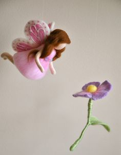 Waldorf inspired needle felted girl mobile: Butterfly  fairy with light purple flower.