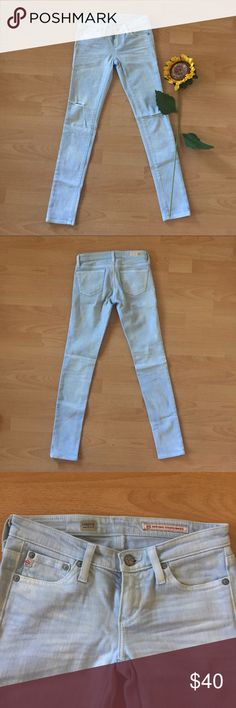 AG Light Blue Skinny Jeans Size 24 J Brand skinny jeans  Size: 24 Style: Legging super skinny fit Color: Light blue  Material: 98% Cotton, 2% Elastane Condition: Pre-owned, gently worn, great condition. 2 small tan stains on left leg (see picture). Ag Adriano Goldschmied Pants Skinny