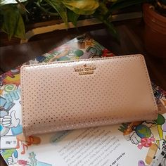 """Kate Spade New York Lilac Street Dot Stacy Wallet Kate Spade New York Lilac Street Dot Stacy Wallet  100% Authentic  Color: Ballet Slipper Style: PWRU4559 Retail: $128.00  Patent Leather Imported Polyester lining Snap closure 3.5"""" H x 6.75"""" L x 1"""" W Long bifold wallet in allover polka dot patterning featuring hardware logo at front Pockets: 4 interior slip, 1 exterior zip, 1 ID window, 12 card slots kate spade Bags Wallets"""
