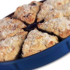 Sweeter than biscuits, scones have struck the American fancy and are showing up everywhere. Scones may be embellished with just about any fruit or flavoring that you can imagine. The following is a basic recipe to try in your new scone pan. It's easily altered by the addition of different dried fruits, nuts, chocolate chips, and/or spices.    Making scones or biscuits is quick and easy. For best results remember two points for mixing:  1) Make sure the dry ingredients are whisked or…
