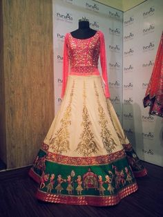 red and off white lehenga