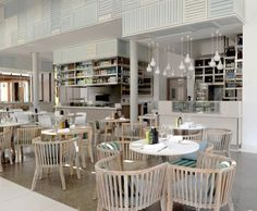 Hotels & Resorts, Contemporary Long Beach Hotel with Different Interior Design: Family Restaurant With Round Table And Wood Chairs