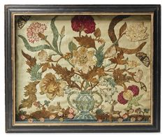 Important Cut Silkwork Flower Picture, Philadelphia, circa 1800 -  double-handled urn of flowers with a rabbit, deer and a butterfly, comprised of thousands of small pieces of multi-colored silk and housed in its original black-painted shadow-box frame. 18 by 21 1/2 in.