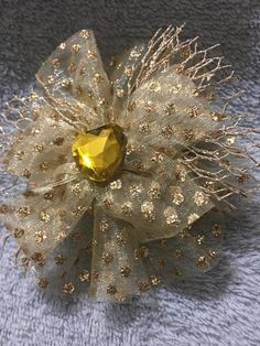 This exquisite bow has gold Iridescent polka dot chiffon underlay, a gold fishnet bow, topped with a gold iridescent chiffon bow with a golden jewel in the middle. This truly one of a kind bow is approximately Handmade Hair Bows, Handmade Gifts, Gold Hair Bow, Christmas Floral Arrangements, Head Bands, Baby Head, Heavenly, Iridescent, Polka Dots