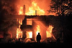 Image result for silhouette in front of burning house