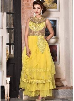 Get a dazzling look dressed in this yellow embroidered net sleeveless gown. The butta, lace, moti, patch, resham and stones work looks chic and fantastic for any function. Bridal Dresses 2015, Party Wear Dresses, Party Gowns, Yellow Evening Gown, Yellow Gown, Buy Gowns Online, Indowestern Gowns, Net Gowns, Yellow Dress Summer