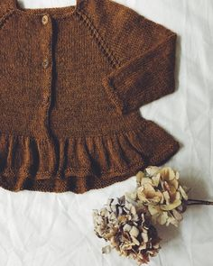 Most awesome knitted cardi, and with flounce! By Mille Fryd Knitwear