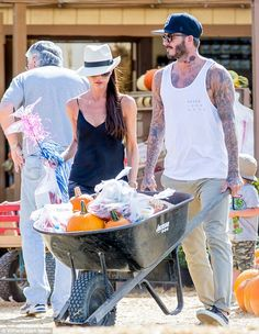 Ready for Halloween! David and Victoria Beckham were pictured stocking up on a quite few g...