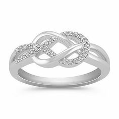 This breathtaking fashion ring highlights 28 round diamonds, at approximately .11 carat total weight. This sparkling ring is crafted in quality sterling silver and forms a unique knot design.