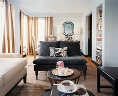 July August 2011 Issue Photo - A gray settee in an open living-dining space