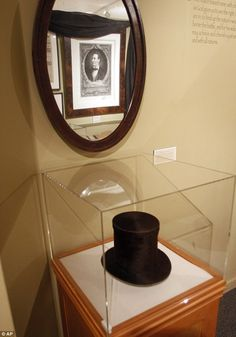Part of history: The stove pipe hat and mirror used by Abraham Lincoln is seen at the Robert Todd Lincoln mansion Hildene Robert Todd Lincoln, Abraham Lincoln Family, Steven Spielberg Movies, Vermont, Old Houses, Stove, Manchester, Trips, Hat