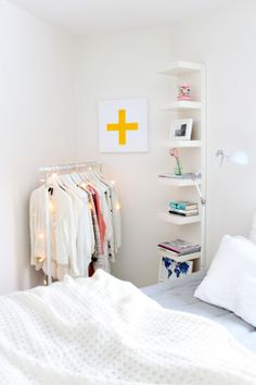calming space with exposed closet and semi floating bookshelf as bedside table. love the use of white and small pops of colour Ikea Lack Shelves, Floating Bookshelves, Lack Shelf, Wall Shelves, Dream Bedroom, Home Bedroom, Bedroom Decor, Bedrooms, Interior Ikea