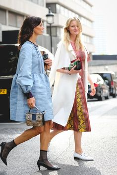 30 Brilliant Street Style Moments From 2016 #refinery29 http://www.refinery29.com/2016/12/133987/best-street-style-2016#slide-10 Candice Lake (right) wears a Burberry dress and Dorateymur shoes with a Christopher Esber coat. Hedvig Sagfjord Opshaug (left) wears a Roksanda dress, finished off with Chanel boots and a Jimmy Choo bag. It doesn't get chic...