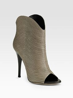 These are Guiseppe Zanotti Contrast Stitch Ankle boots. These are my favorite! $895