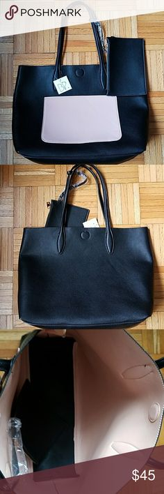 "BP. Colorblock Pocket Large Tote Bag Nwt! BP. Colorblock Pocket Large Tote Bag  -faux leather -colors: black and baby pink -magnetic closure -comes with matching wristlet  -very spacious and lightweight  -approximately 19"" length and 13.5"" height BP. Bags"