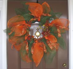 Autumnal Fall wreath in orange and green deco mesh