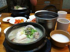 Samgyetang (삼계탕) is Korean style Ginseing chicken soup. You're supposed to eat it on really hot days. You literally eat a whole chicken. It kind of gives your super powers, which is helpful in a lot of situations.
